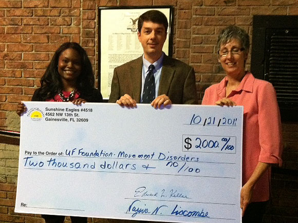 Sunshine Eagles 4518 Terri Cole (right) presents check to Danielle McGee, Center Director, and Dr. Nikolaus McFarland