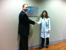 Receiving a Center of Excellence plaque shortly after the opening of our Interdisciplinary Center in 2011